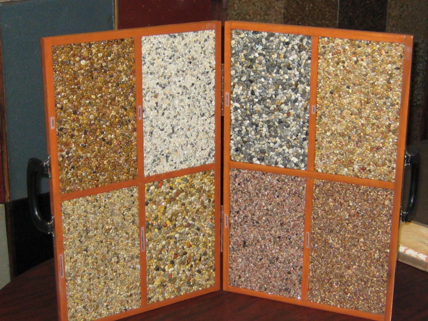 Portable briefcase size river rock samples in 8 colors