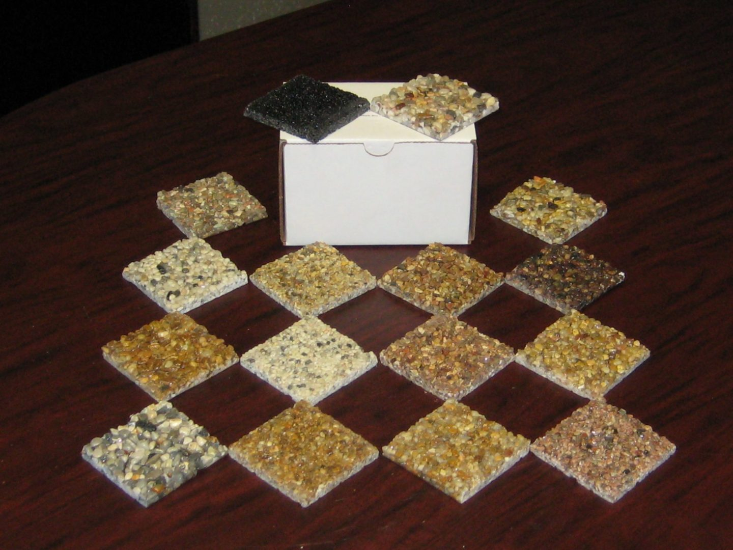 """Box of available 3"""" X 3"""" river rock color samples"""